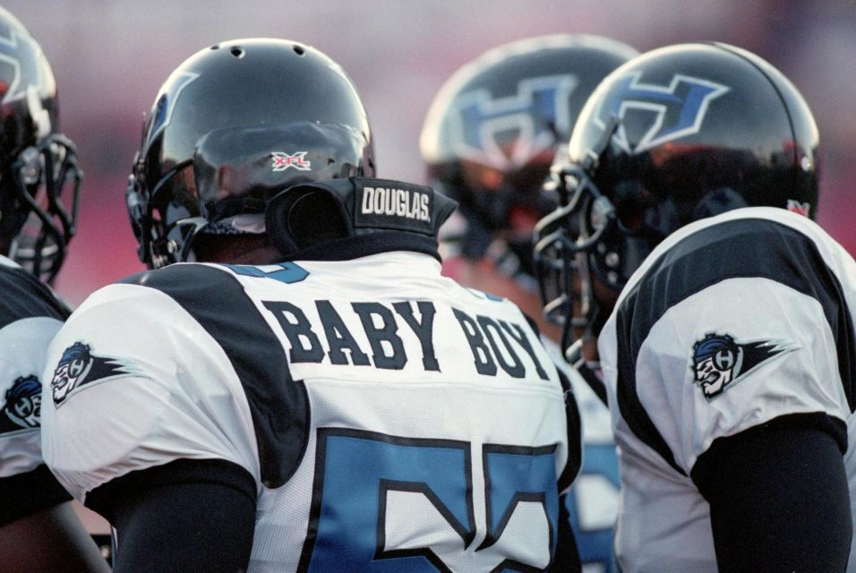 Haven Fields (Baby Boy) of the New York/New Jersey Hitmen stands in the team huddle during an XFL game against the Las Vegas Outlaws at the Sam Boyd Stadium in Las Vegas, Nevada.