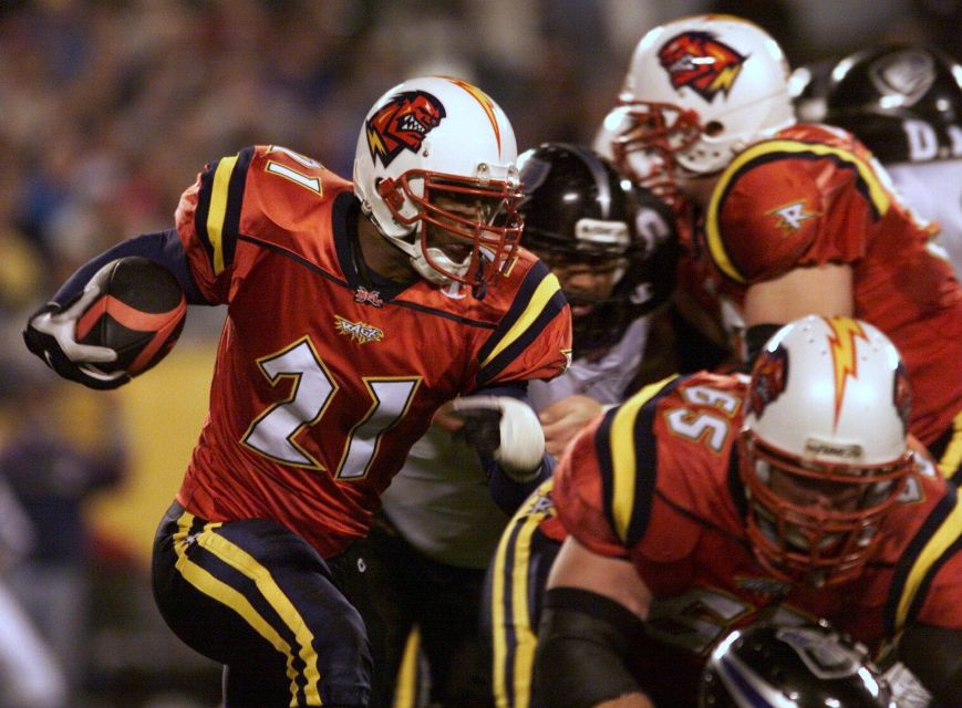 Michael Black #21 of the Orlando Rage runs with the ball against the Chicago Enforcers during XFL opening night at the Citrus Bowl in Orlando, Florida.