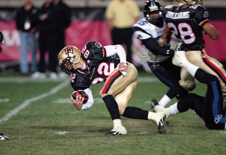 Mike Furrey of the Las Vegas Outlaws runs with the ball during an XFL game against the New York/New Jersey Hitmen at the Sam Boyd Stadium in Las Vegas, Nevada.
