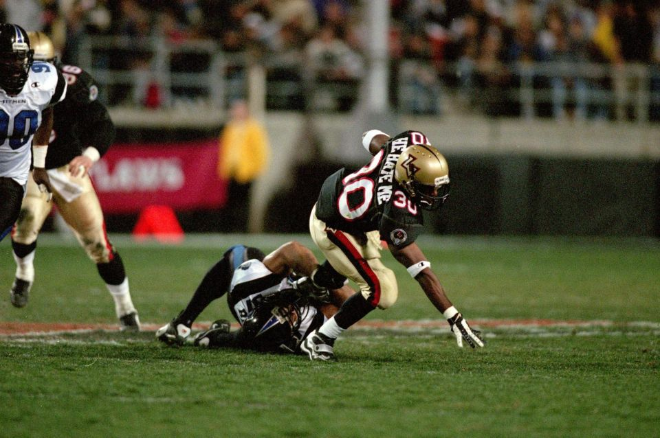 Rod 'He Hate Me' Smart of the Las Vegas Outlaws gets tackled during an XFL game against the New York/New Jersey Hitmen at the Sam Boyd Stadium in Las Vegas, Nevada, on Feb. 3, 2001.