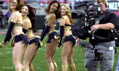 Feb. 17, 2001, a television cameraman photographs the Los Angeles Xtreme cheerleaders before the start of an XFL football game between the Xtreme and the Las Vegas Outlaws in Las Vegas.