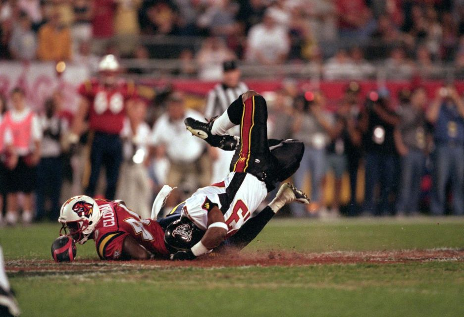 Brandin Young of the San Francisco Demons and Scott Cloman of the Orlando Rage scramble for the ball for the opening coin toss during an XFL game at the Citrus Bowl in Orlando, Florida. The Rage defeated the Demons 26-14.