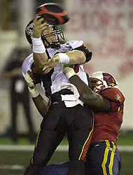 San Francisco quarterback Pat Barnes releases the ball just as he is hit by Orlando free safety Omar Brown